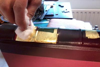 Gold leaf is carefully pressed on using cotton wool